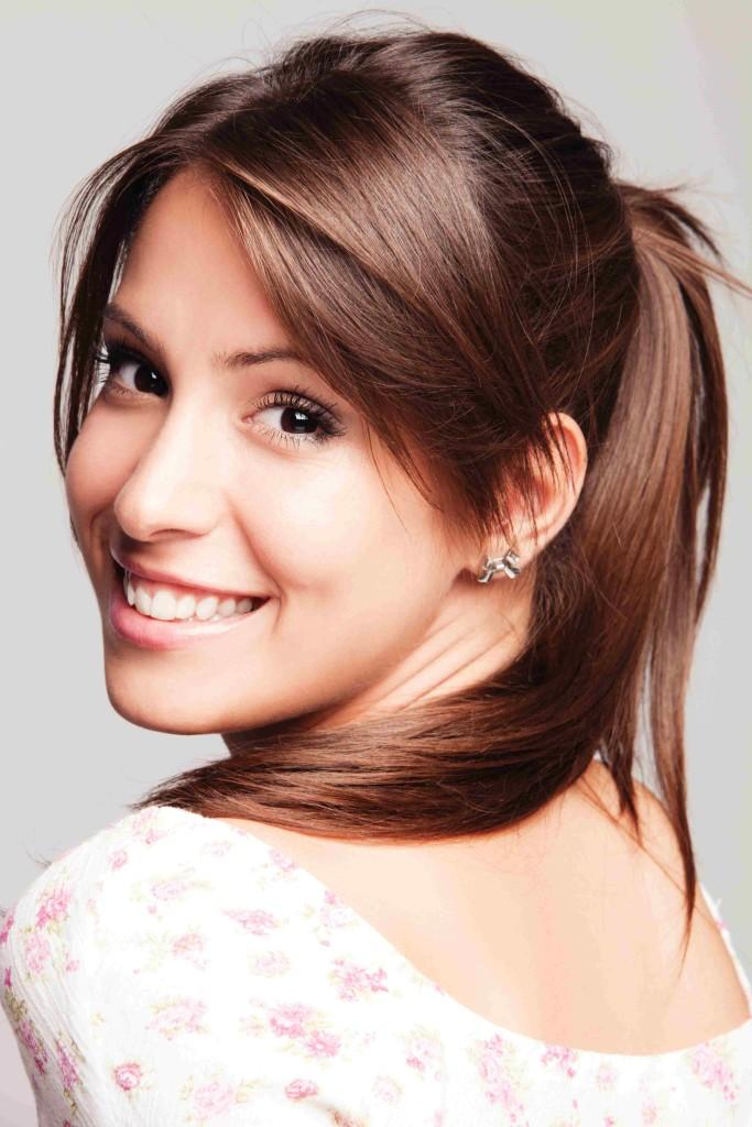 friendly smiling young woman portrait studio shot